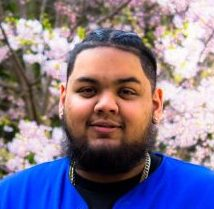 A photo of Jay Seepersaud, VP Promotions 2019/2020, standing in front of a blossoming Japanese cherry tree.
